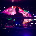 DJ mixing beats in nightclub
